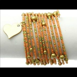 Peach & gold beaded slinky charm bracelet NWT